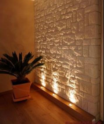 Paredes decoradas de piedra e iluminación indirecta, revestimiento, espacios