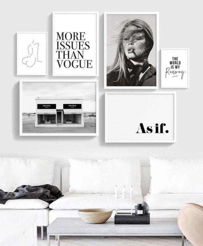 Paredes de habitación y oficinas decoradas con cuadros y fotos